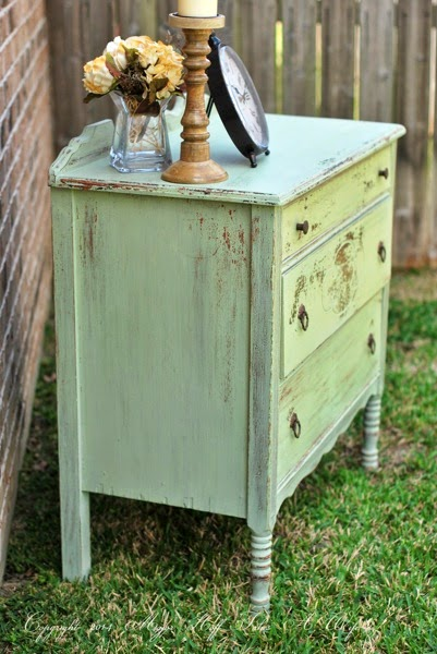 Side of antique dresser painted in Miss Mustard Seed Luckett s Green Milk Paint