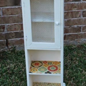 Jelly jar cabinet redo: How to decorate a worn piece of furniture by decoupaging with scrapbook paper
