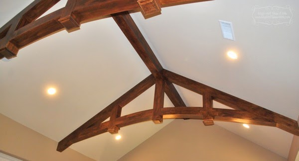 Tour it thursday classic texas house with wood beams for Arched ceiling beams