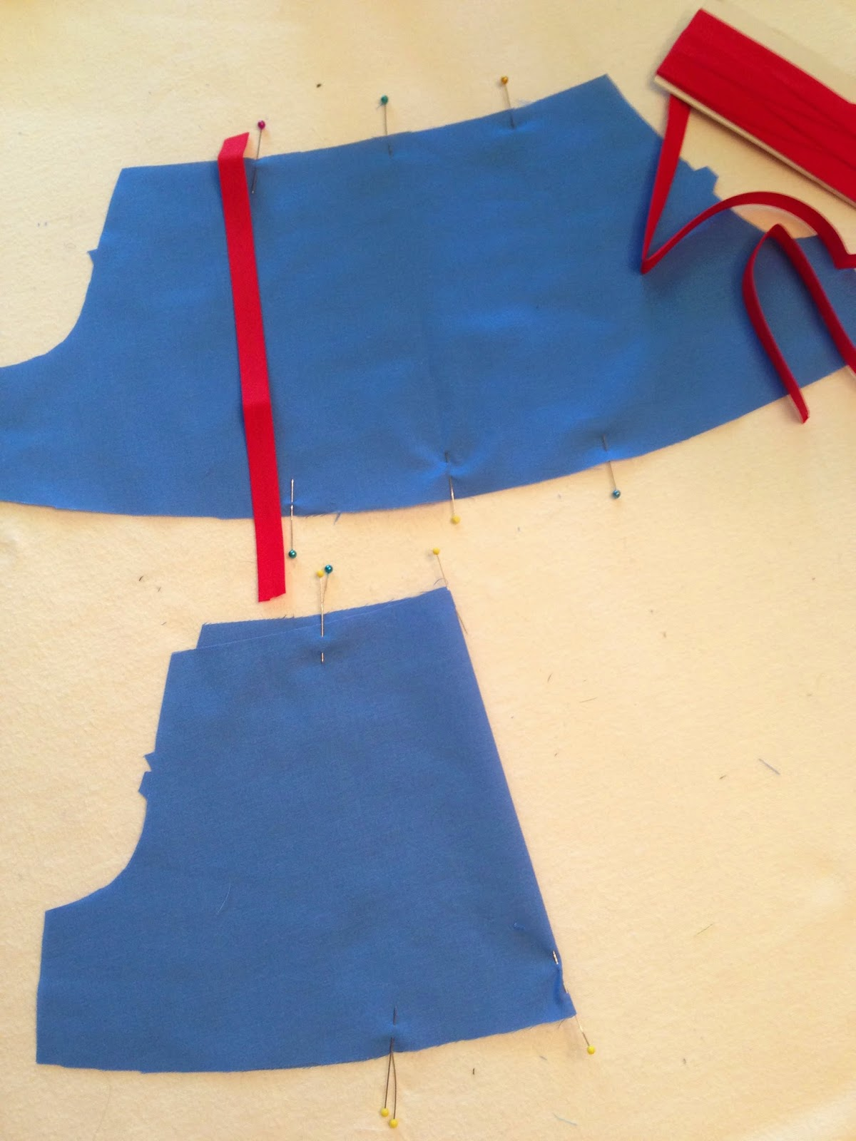 Adding trim to snow white costume sleeves
