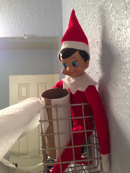 Elf on the shelf with TP roll in basket