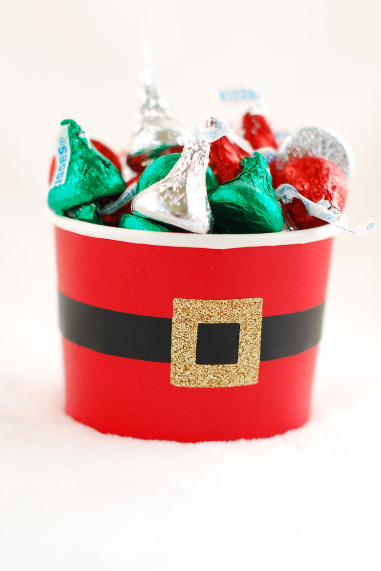 hershey kiss candy stacked in a round red candy cup with a santa belt for holiday gift idea