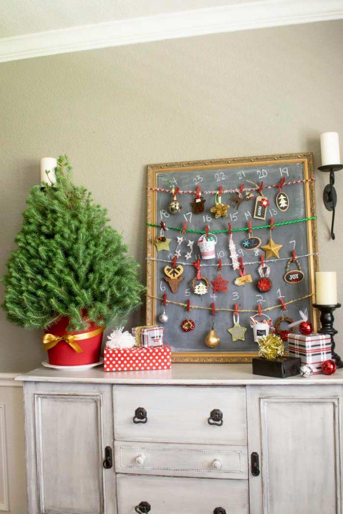 homemade advent calendar made with a chalkboard and a mini christmas tree