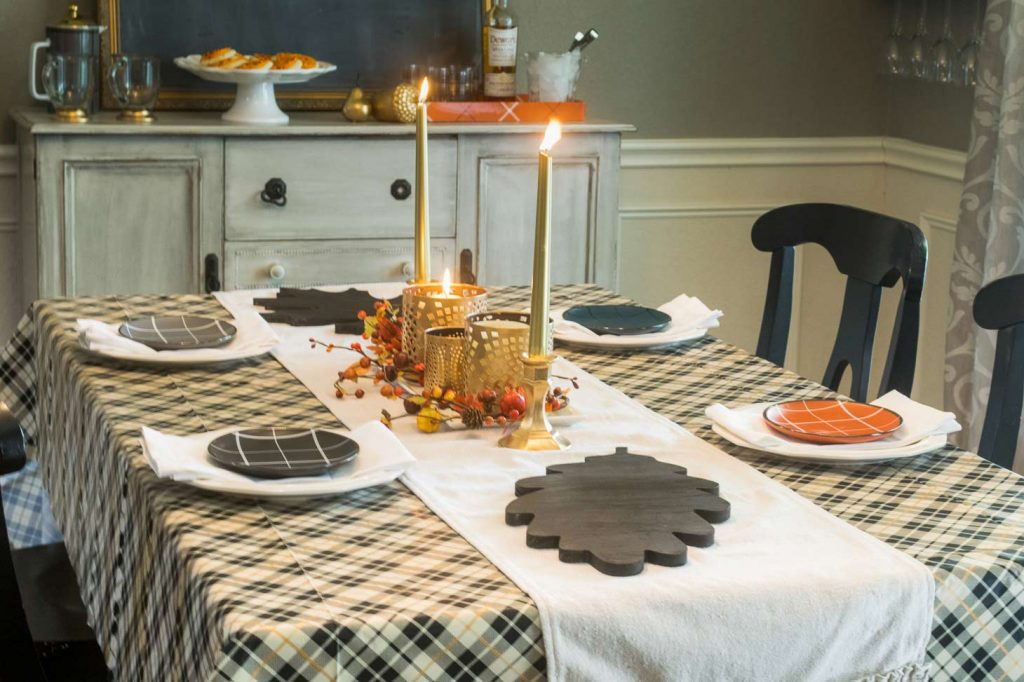gold thanksgiving centerpiece that is elegant in a plaid dining room