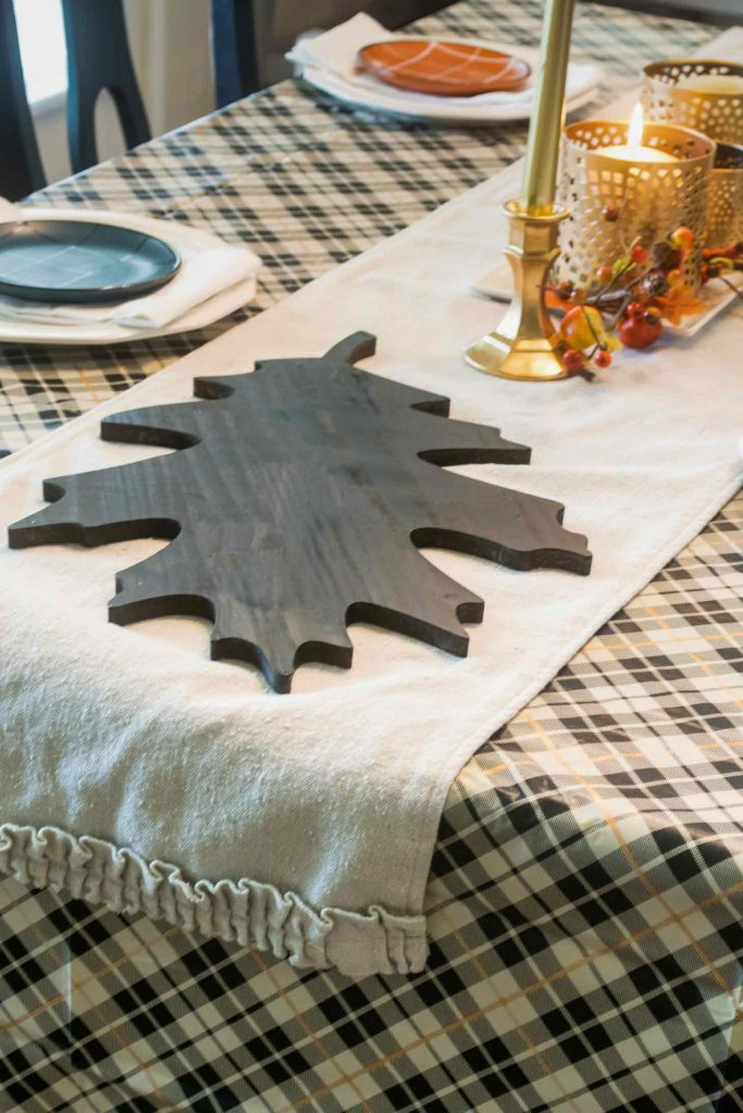 Stain oversized thick wooden leaves to use as a trivet on Thanksgiving