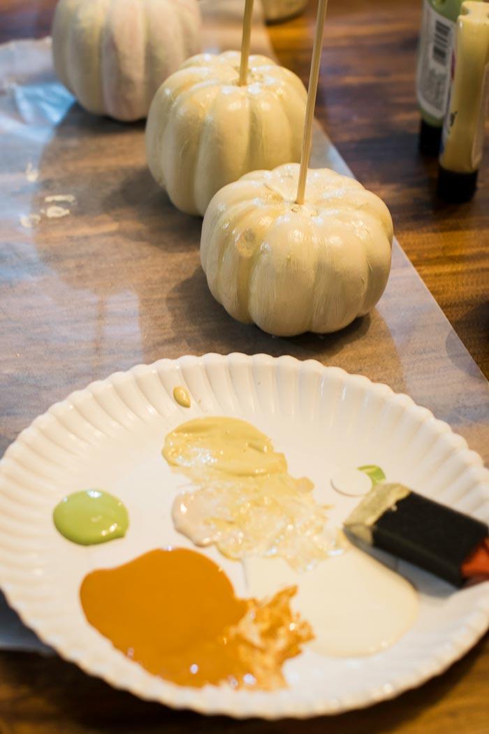 painting dollar store pumpkins