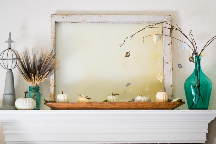 decorating a Fall mantel crafted with a cricut machine