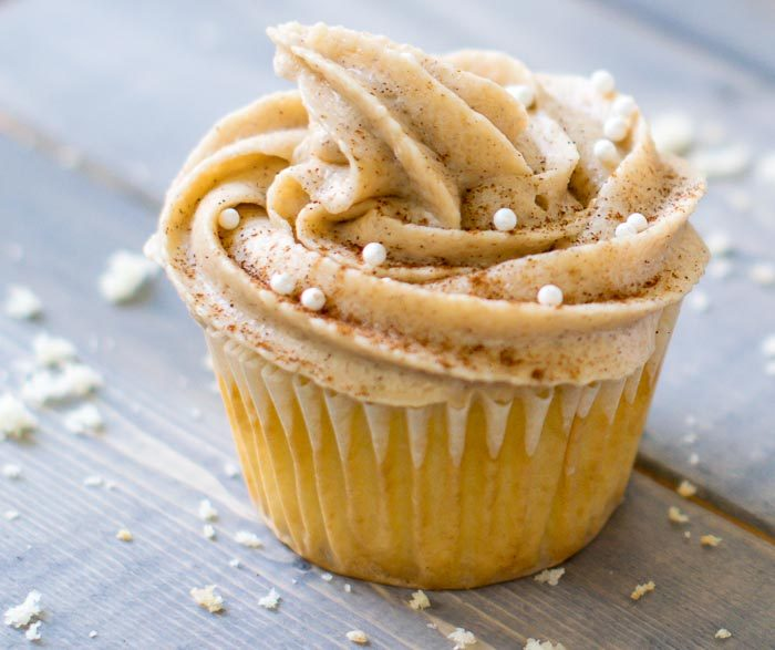 Maple Snickerdoodle Cupcakes with maple frosting. Effortless maple frosting tops these snickerdoodle cupcakes inspired by fall. Recipe for the maple buttercream includes cinnamon and brown sugar for the perfect touch of autumn.