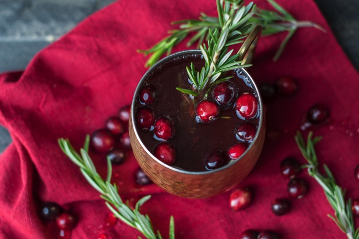 Looking for a holiday drink recipe? Try this refreshing, unique, and festive Rosemary and Cranberry Moscow Mule that features tastes of the holiday season!
