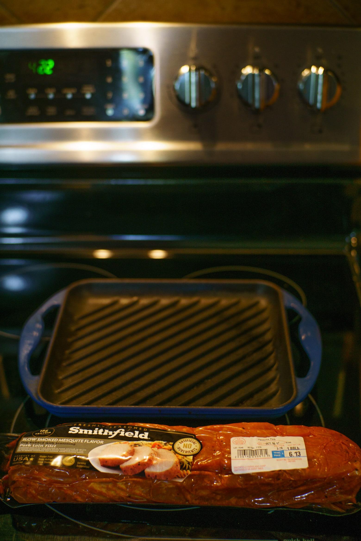 Grilling pork tenderloin on a stovetop for pork tenderloin sandwiches