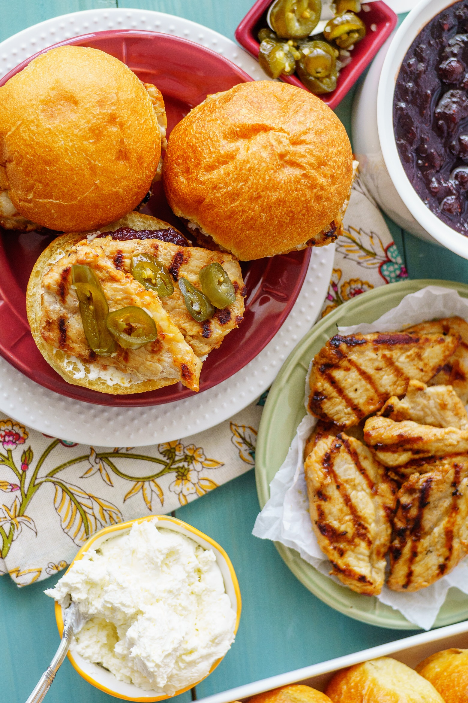 A spicyjalapeñocranberry jelly tops these grilled pork tenderloin sandwiches to make a fast and tasty weeknight meal in under 30 minutes!