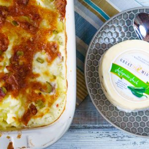 Scalloped potatoes with bacon and jalapenos adds a spicy twist on your favorite creamy and cheesy dish. Features jack cheese, cream cheese, bacon and more!