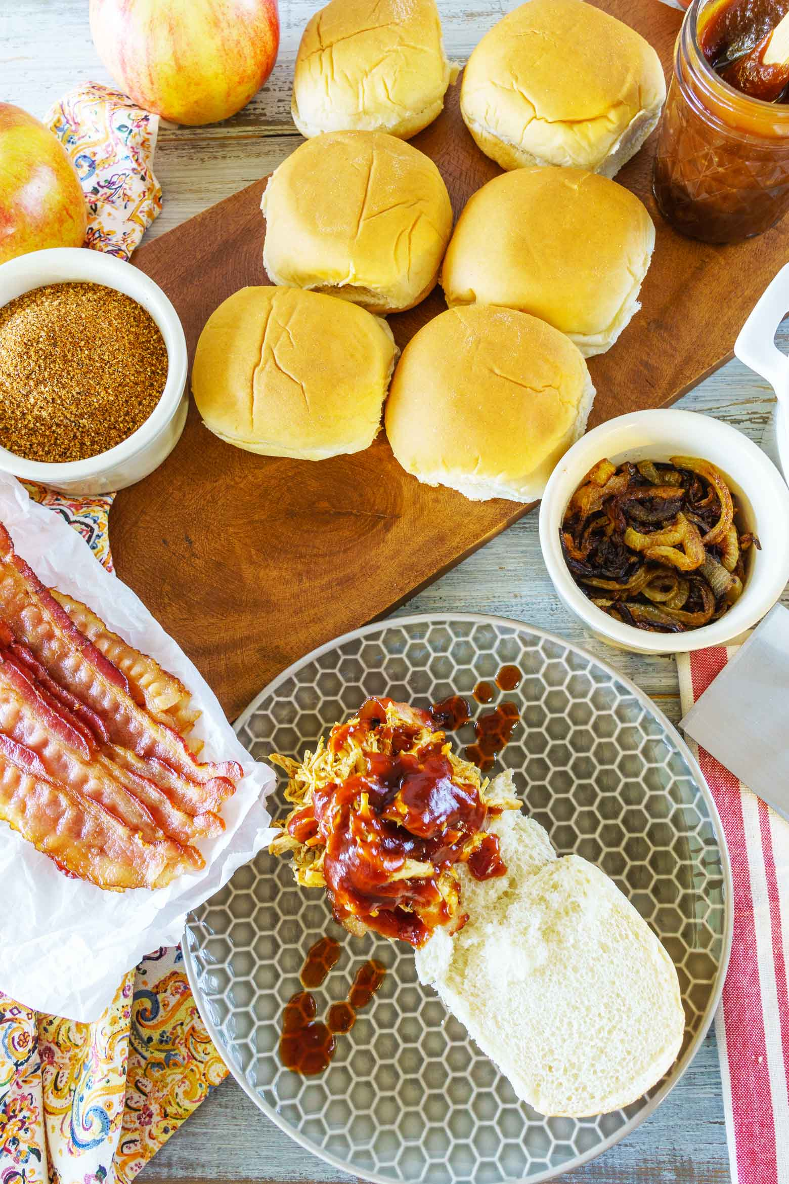 Pulled chicken sliders will be your new favorite snack on game day! They also make a quick week night meal full of flavor. Stacked with caramelized onion, pulled chicken breast smothered in a spicy dry rub, maple bbq sauce and a special ingredient you'd never guess! All made in a pressure cooker to save you time!