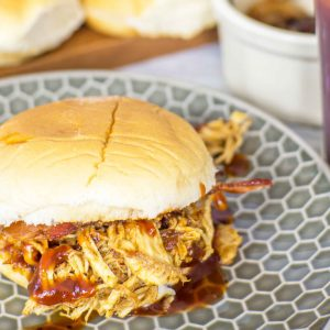 Pulled chicken sliders will be your new favorite snack on game day! They also make a quick weeknight meal full of flavor. Stacked with caramelized onion, pulled chicken breast covered in a spicy bbq rub, maple bbq sauce and a special ingredient you'd never guess! All made in a pressure cooker to save you time!