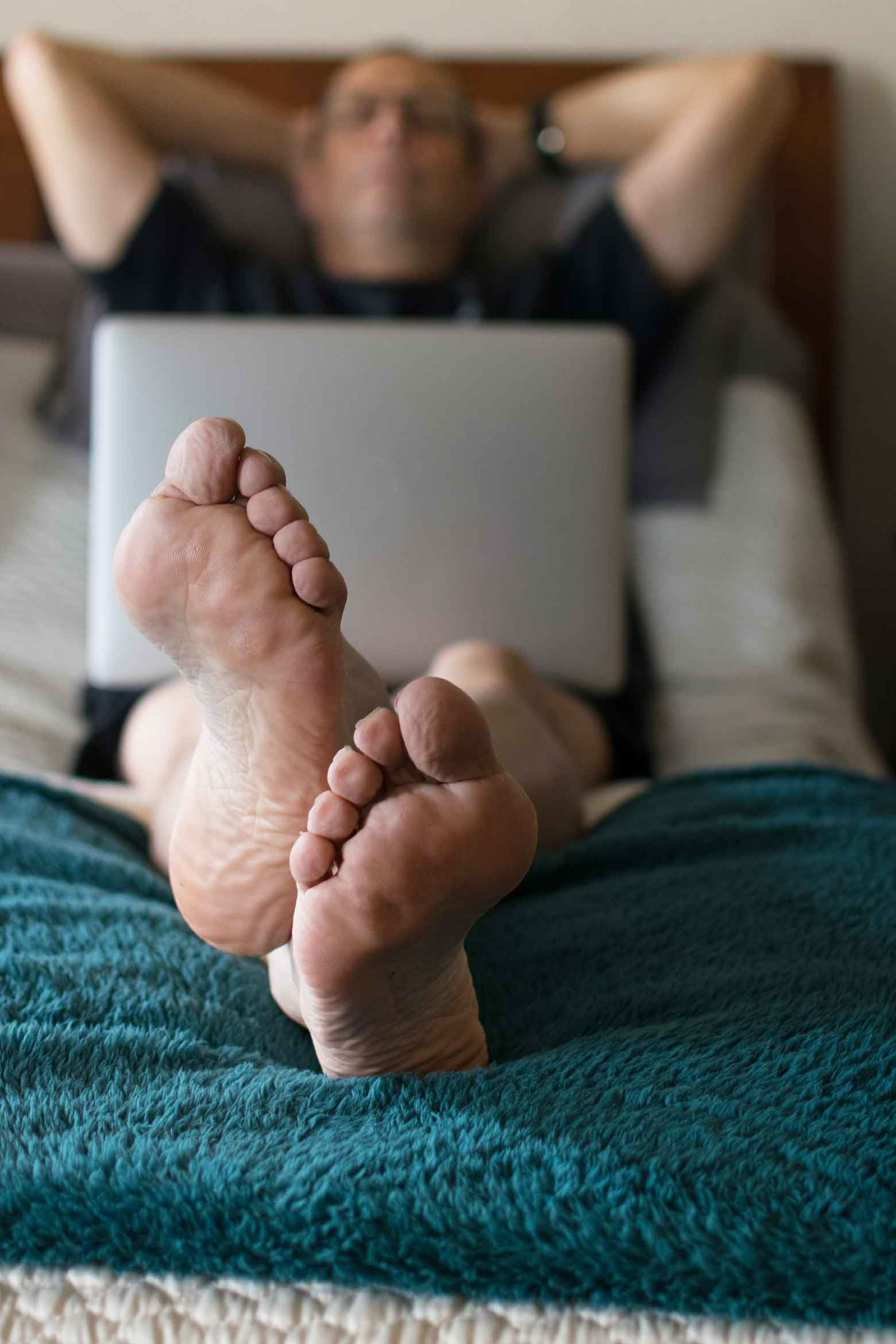 Feet and Laptop on a LulaaBED matress