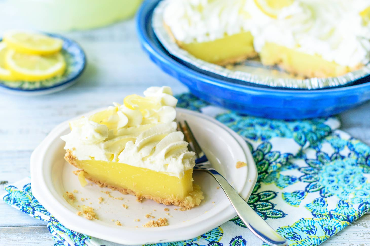 easy lemon pie with whipped cream and a cookie crust