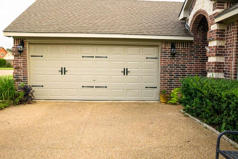 two sets of carriage door hardware on a double wide roll up garage door