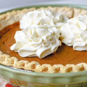 Molasses pumpkin pie is a perfect traditional dessert for your Thanksgiving feast! This old fashioned pumpkin pie recipe with molasses is a hit with guests!