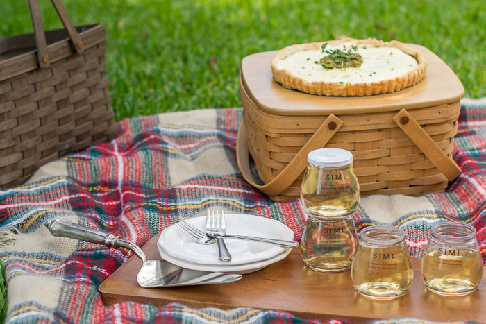 caramelized onion tart with goat cheese served at a picnic with wine