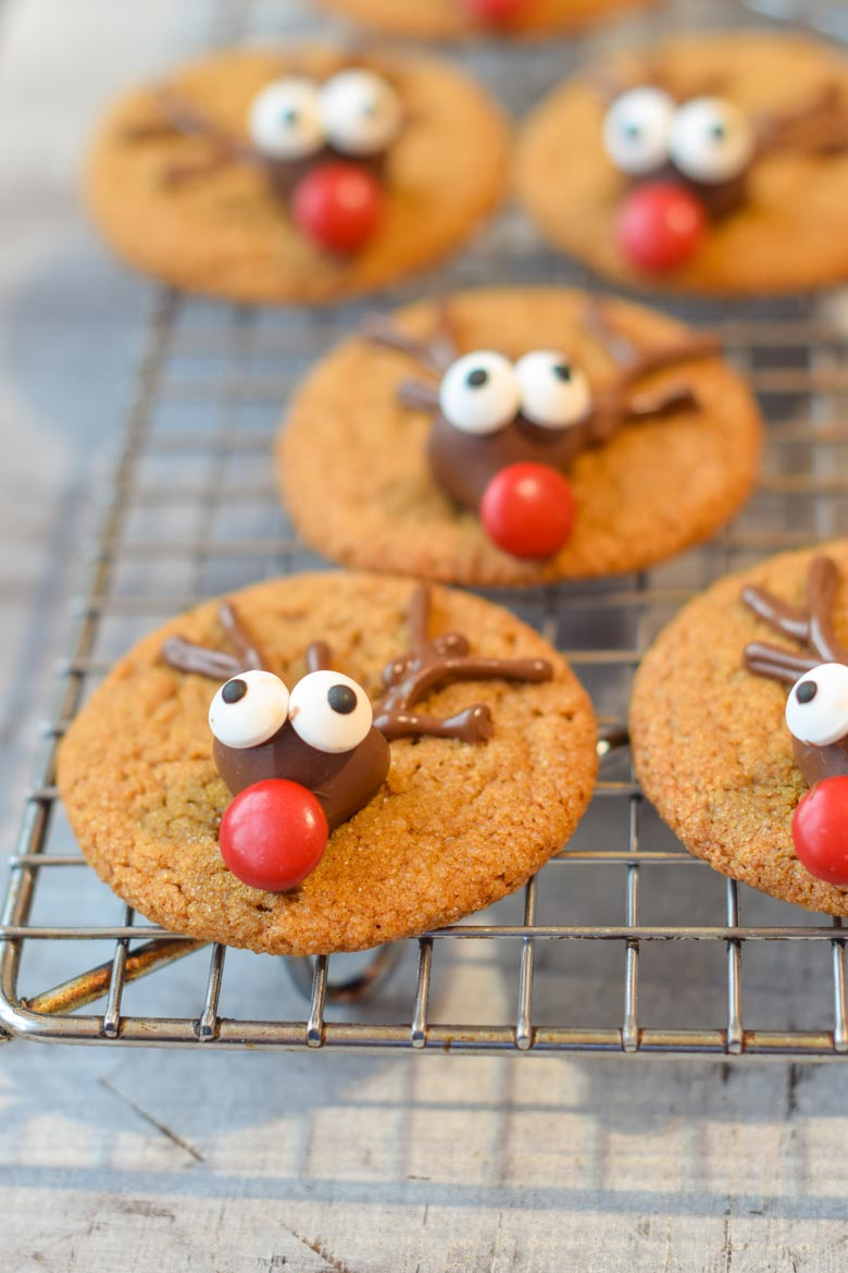 adding a red nose to a reindeer cookie
