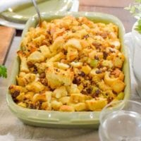 Ditch the box and see how easy it is to make homemade Sausage stuffing this Thanksgiving. Fresh bread, sausage, hints of sage ,chunks of apple and dried cranberries make this sausage stuffing dish the star of the show! Serve in a casserole dish as a side dish or stuff the turkey! Easy to substitute other favorites like Italian sausage or cornbread. Families adore this recipe that can be a main meal in itself when you are seeking those Thanksgiving comfort food favorite flavors!