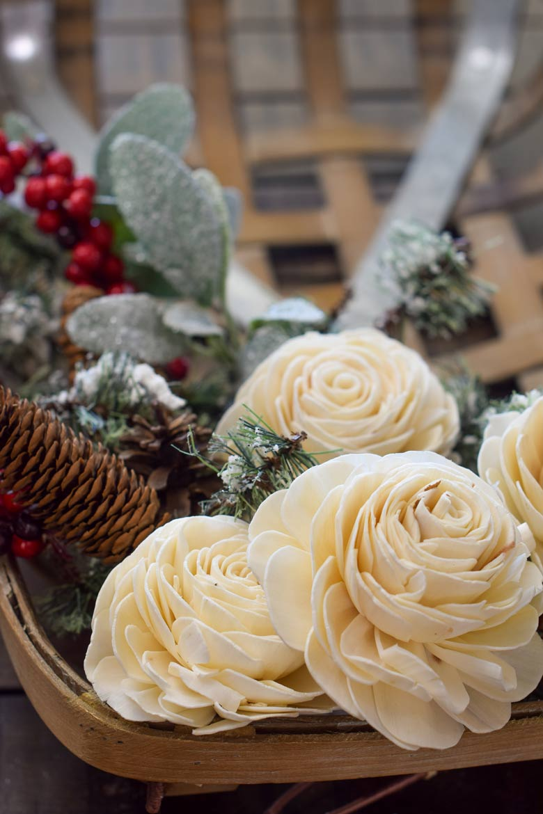 Foam floral flowers look like dried wooden roses on this tobacco wreath