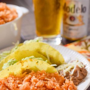 Mexican feast with Modelo beer, tacos, refried beans and homemade rice